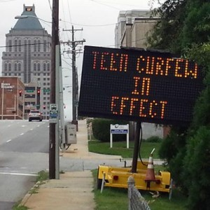 Sign announcing teen curfew in downtown Greensboro